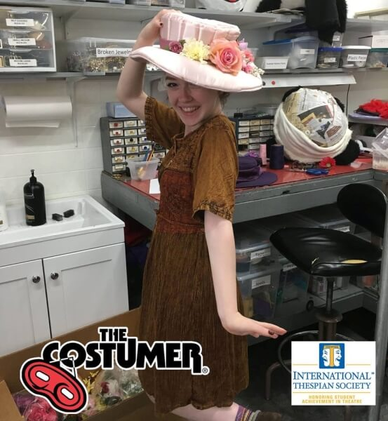 Grace White International Thespian Society Intern for The Costumer Modelling one of the many hats worn at The Costumer